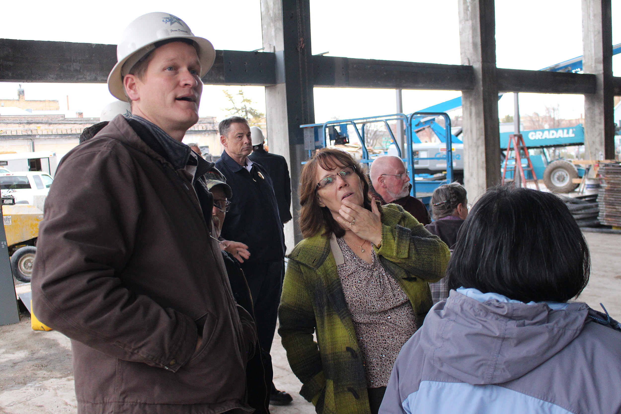 Project Manager Jason Derricott talks with Councilwoman Suzanne Hawkins about the future City Hall during a tour of the site on Monday, Feb. 6, in downtown Twin Falls. (Photo by Andrew Weeks)