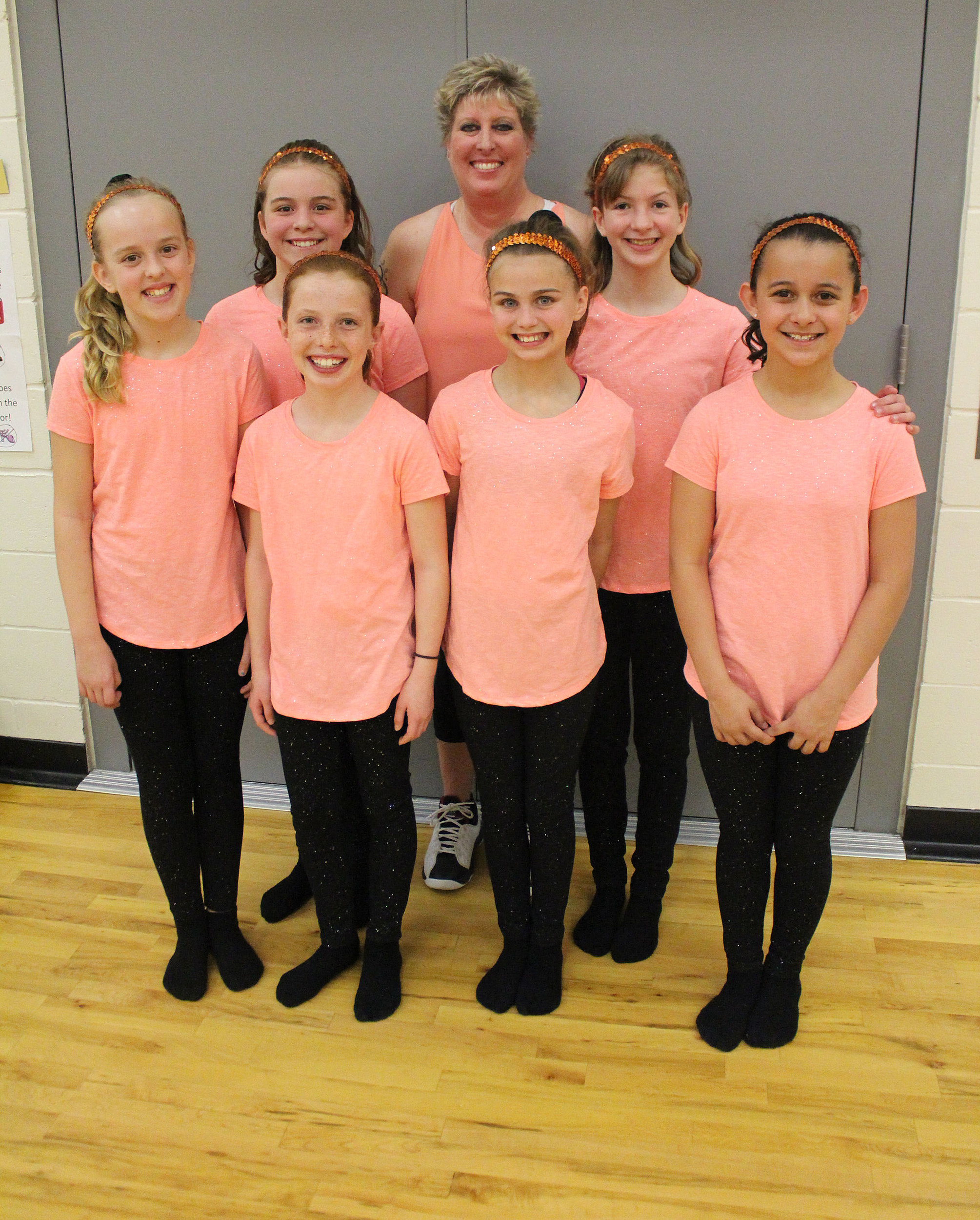 Darla Petersen, physical ed teacher at Sawtooth Elementary School, poses for a photo with students who competed in a dance competition for Fuel Up to Play 60. Petersen and the girls came up with the dance the routine and shared it on YouTube. (Photo by Andrew Weeks)