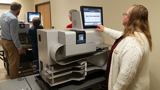 Twin Falls County Elections Director Valerie Varadi tests a ballot counting machine on Monday afternoon at the County West Building. (Photo by Andrew Weeks)
