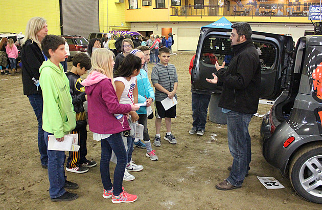 Benito Baeza, news director for News Radio 1310, explains about a career in broadcast radio and digital journalism to Twin Falls School District fifth-graders at the 'Careers on Wheels' event on Wednesday, May 17, at the CSI Expo Center in Twin Falls. (Photo by Andrew Weeks)