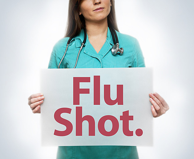 Doctor with Flu Shot sign (Click for more)